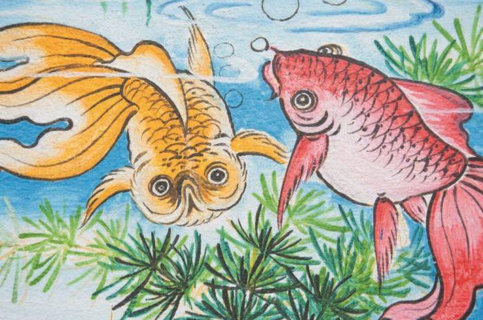 Китайская золотая рыбка. Изображение на стене в китайском храме